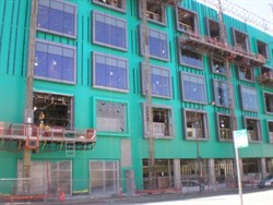 Building envelope commissioning includes an air barrier