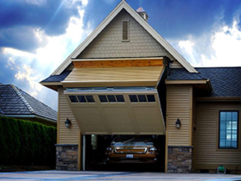 RV owner sidesteps zoning restriction for unique motorhome garage. Schweiss Doors ... & The Ultimate Hidden Door | Metal Architecture