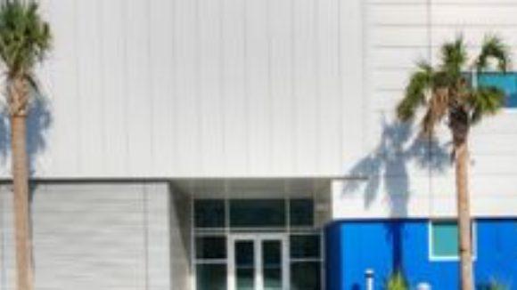 Metal panels align aircraft factory design