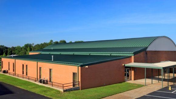 Metal re-roof covers school