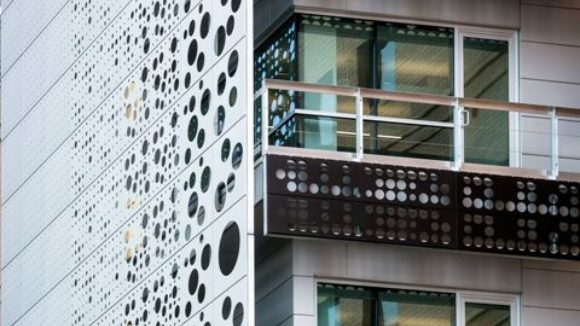 Elevator tower features perforated panels