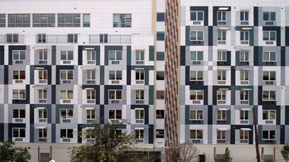 Metal panels form smooth appearance on apartment building
