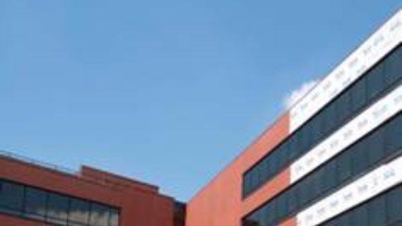 University enrolls metal panels to replace terra cotta