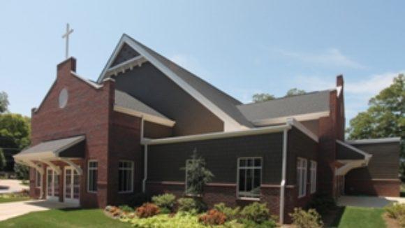 Multiple metal buildings form church