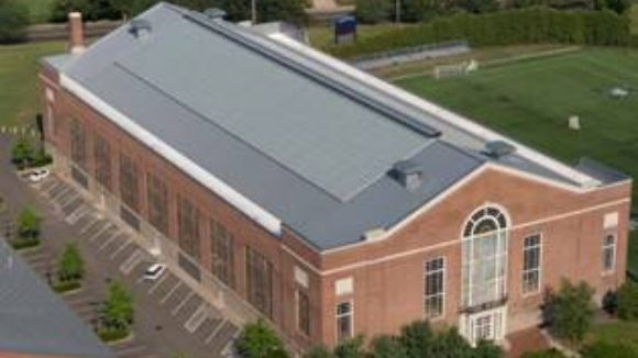 Metal roof joins university field house