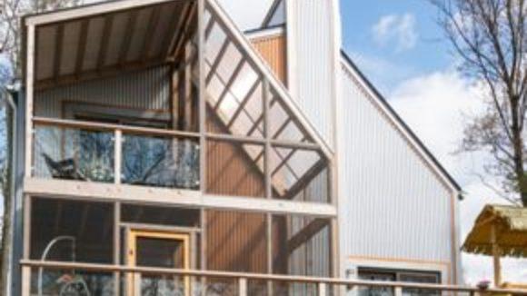 Metal panels emphasize house's vertical design