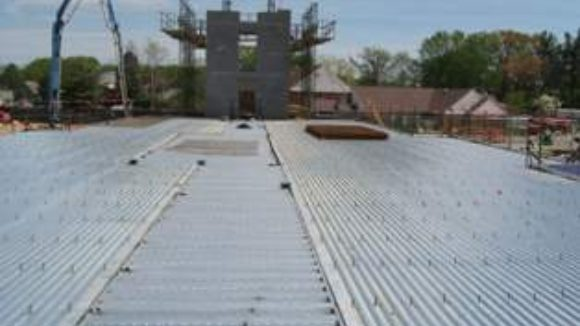 Utility equipment resides on metal roof
