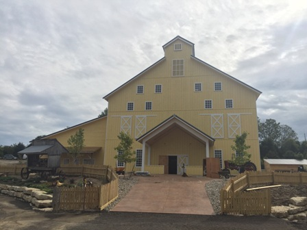 Vala's Pumpkin Patch designed its Egg Scramble attraction barn in Gretna, Neb., with a metal building system, rough sawn lumber for siding and a metal roof to fit with the company's rustic farm theme.
