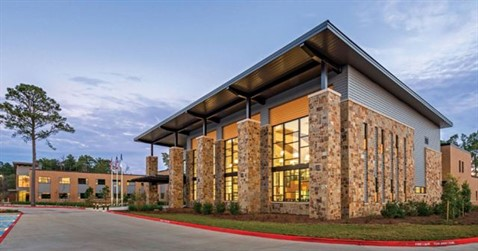 PBK Inc. selected colors and patterns for Creekside Center at Lone Star College (LSC) in The Woodlands, Texas, to combine with the stone of the building, meet the zoning requirements and blend with the community.