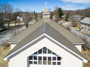 Rood Roofing installed approximately 12,000 square feet of Englert Inc.'s 24-gauge, 20-inchwide Series 1300 standing seam metal roof panels in Medium Bronze on St. Ann's Church in Milton, Vt.