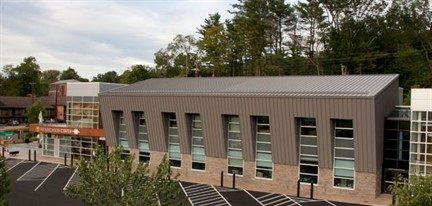 Three-coat custom slate gray metal panels supplied by Englert Inc. were installed on one side of the Education Center at the Turtle Back Zoo in West Orange, N.J., and function as wall panels around a series of large mullioned windows.