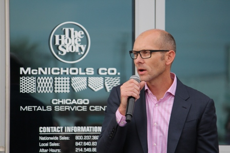 Scott McNichols, president at McNICHOLS Co., addresses the crowd at the company's ribbon-cutting for its new distribution center in the Chicago area.