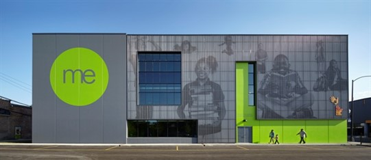 Creative metal! Images of children show through perforated metal on the façade on Moving Everest Charter School and By The Hand Club For Kids. Bright colors accent the design. Photo: Tom Harris, Hedrich Blessing