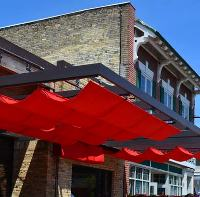 AFX, a division of Sign Effectz, offers customized, roller construction curtain canopies for retail and institutional markets that have a structure designed to withstand extreme weather conditions; the frame, supports and hardware are durable.